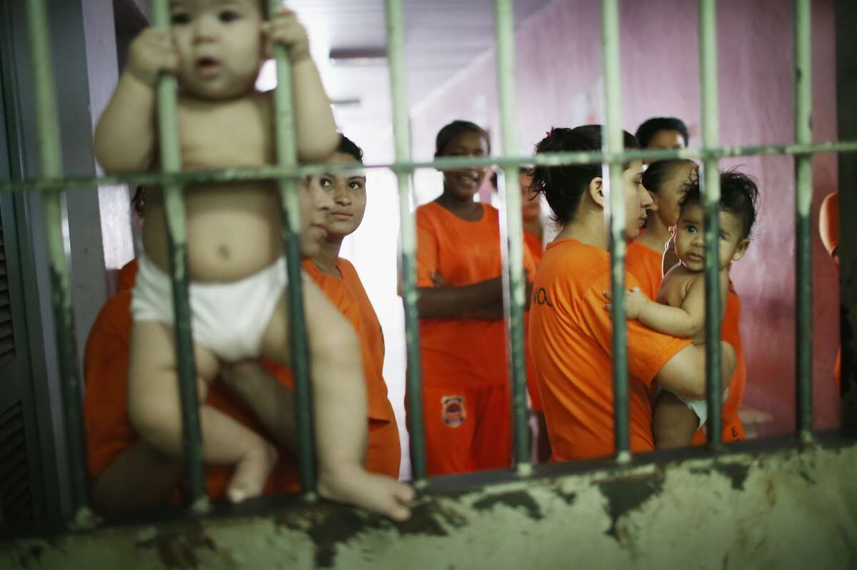 Female inmates gather with babies as they greet visitors in the Pedrinhas Prison Complex, the largest penitentiary in Maranhao state, on January 27, 2015 in Sao Luis, Brazil. Keep clicking to see the inside of Brazil's notorious prison complex.