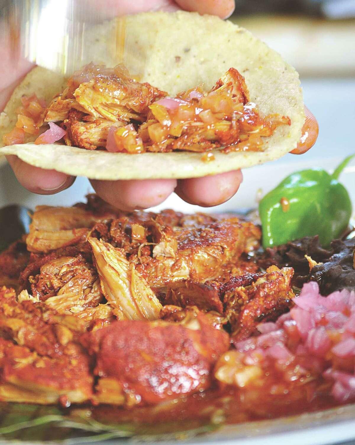 "Cochinita pibil tacos from ""Tacopedia"" by Deborah Holtz and Juan Carlos Mena."