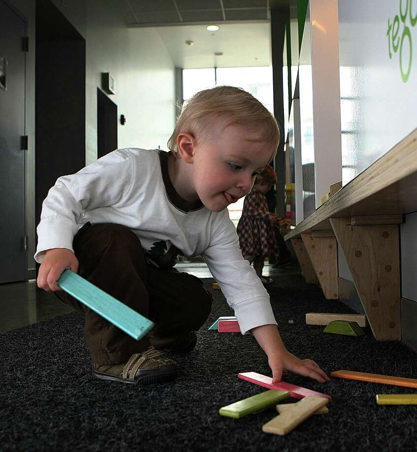 A toddler plays with magnetic toy blocks made by Darien, Conn.-based Tegu, in July 2013 at the Creativity Museum in San Francisco, Calif. In November 2015, Tegu reported raising $3.5 million, with venture funding in Connecticut up significantly in the second half of 2015 compared to the first six months. Photo: Liz Hafalia / The Chronicle / ONLINE_YES