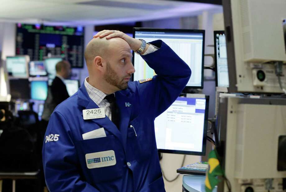 Specialist Meric Greenbaum works on the floor of the New York Stock Exchange on Monday. U.S. stocks are opened 2016 on a grim note, dropping sharply after a plunge in China and declines in Europe. Photo: Richard Drew /Associated Press / AP