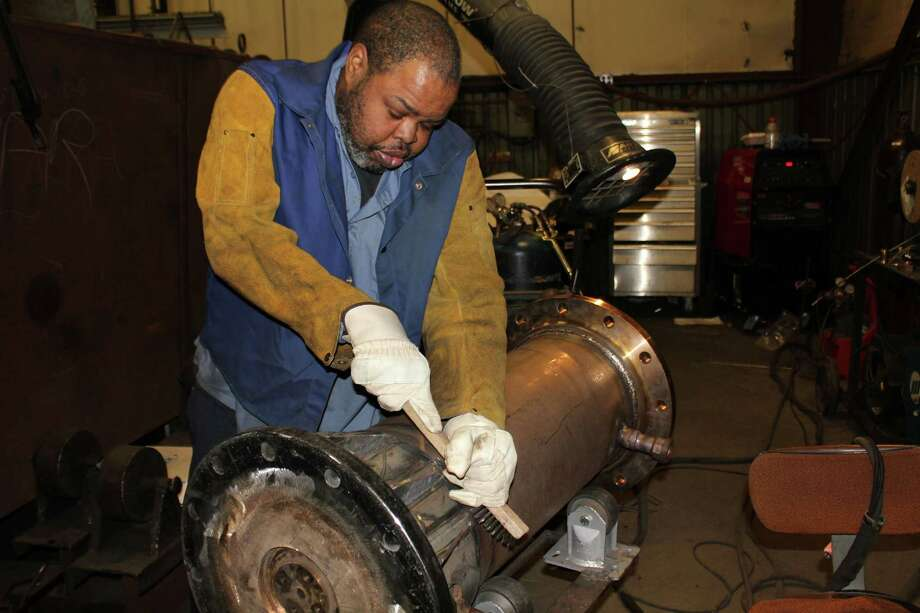 Frank Scott, a welder at Hubbell Electric Heater in Stratford, Conn. works on an electric heater. The company recently said it will add 35 jobs over the next three years. Photo: Contributed Photo / Contributed Photo / Connecticut Post Contributed