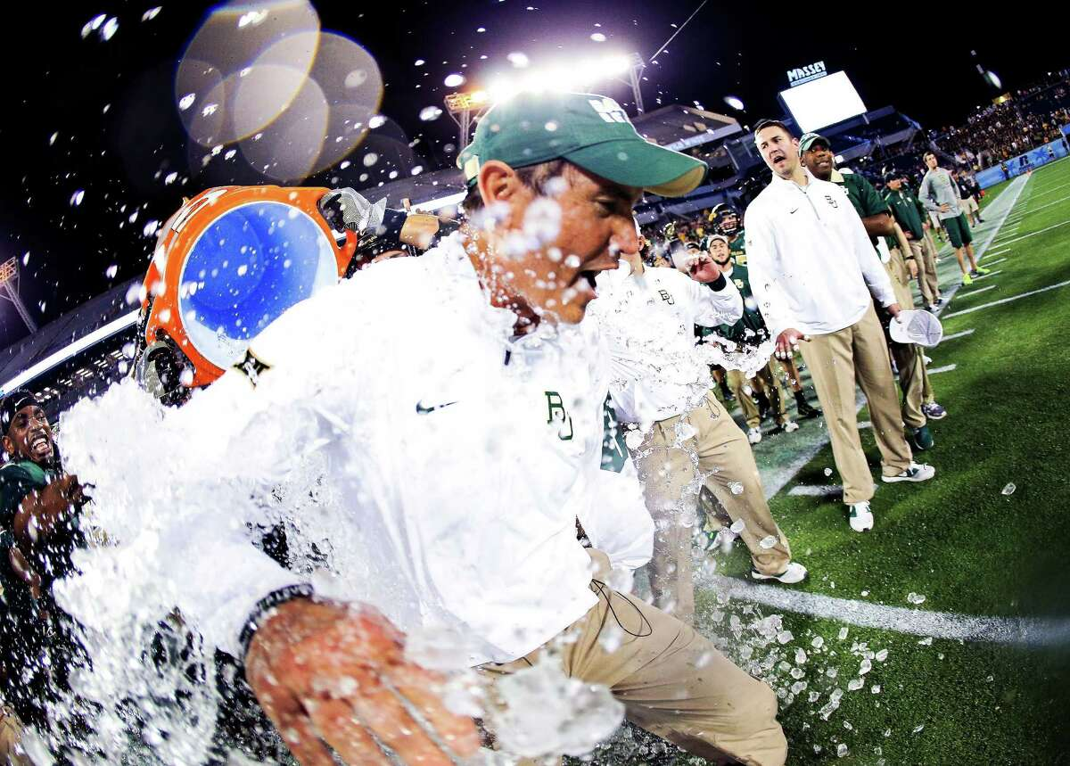 Head coach Art Briles of the Baylor Bears has water dumped on him after the Russell Athletic Bowl game against the North Carolina Tar Heels at Orlando Citrus Bowl on Dec. 29, 2015 in Orlando, Florida.