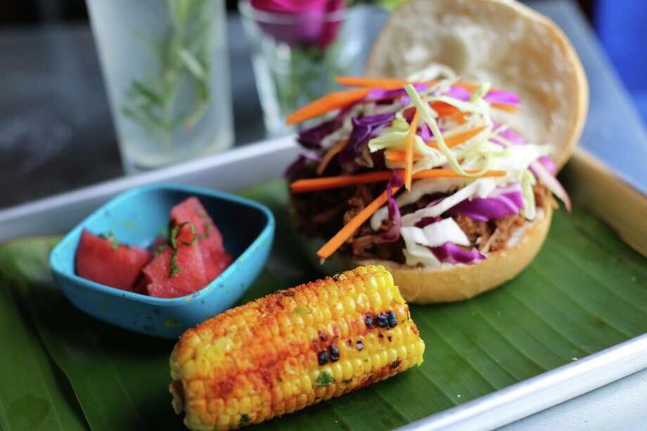 La Botanica: BBQ Jackfruit Sandwich, grilled elote with cilantro butter, Chambord-Infused fruit cup Photo: Arlene Mejorado