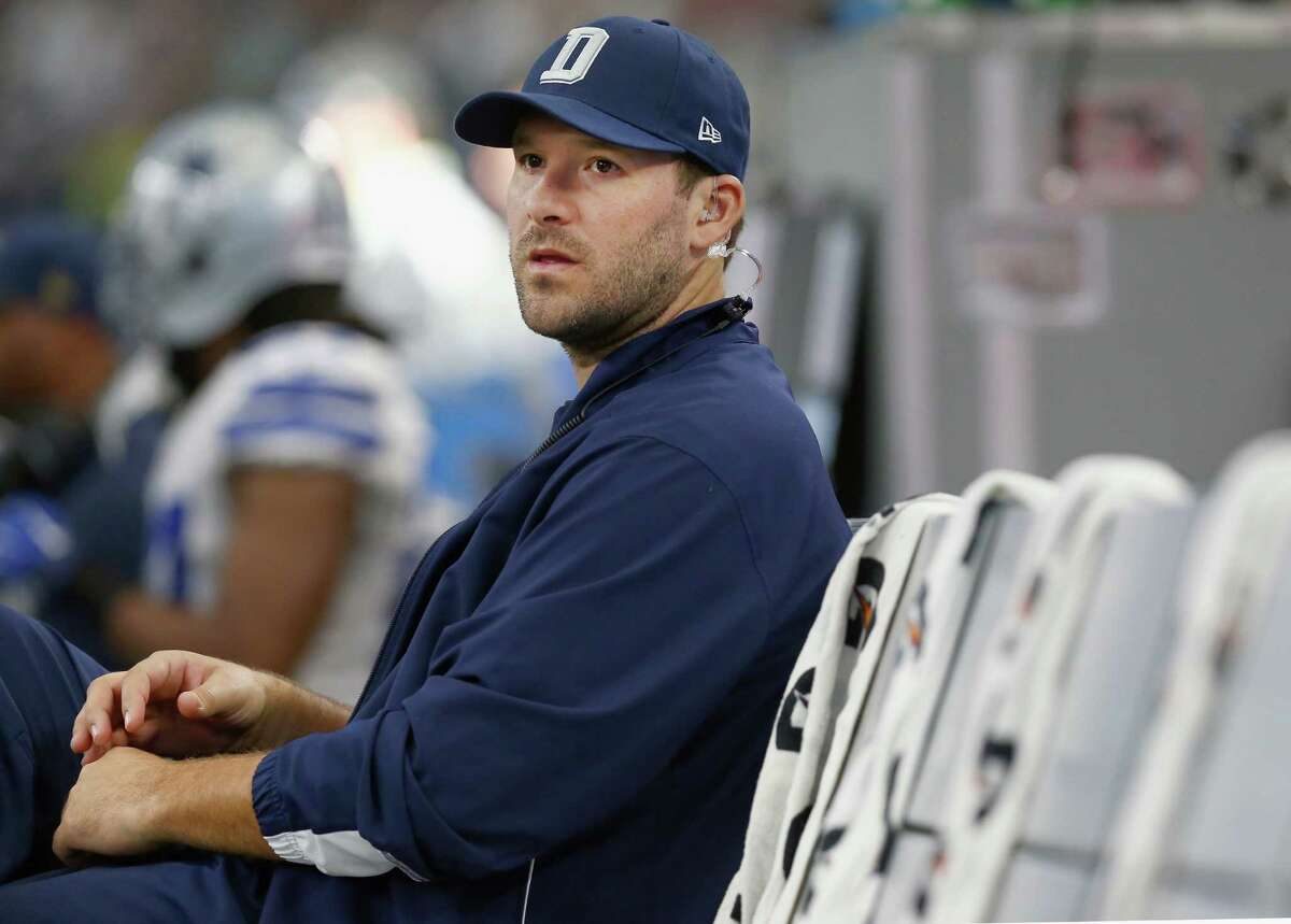Tony Romo of the Dallas Cowboys sits on the bench late in the fourth quarter as the Washington Redskins beat the Dallas Cowboys 34-23 at AT&T Stadium on Jan. 3, 2016 in Arlington, Texas.