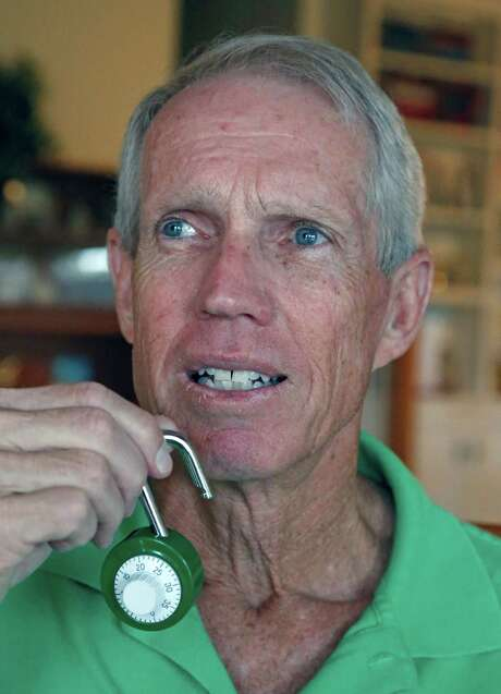 Steve Martin holds the locked that was picked, it has only one notch making it easier to pick. Two of Steve Martin's  credit cards were stolen from his locked locker at an LA Fitness and within about two and a half hours, the thieves charged $8,000. This story is going to be a cautionary tale warning people to secure themselves and their valuables at all times, especially during the holidays when people are shopping. Photos taken on 11.27.1015. Photo: Ron Cortes, Photographer / For The Express-N
