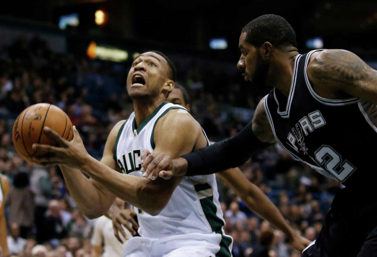 2418 x 1650~~$~~Milwaukee Bucks' Jabari Parker tries to drive past San Antonio Spurs' LaMarcus Aldridge during the first half of an NBA basketball game Monday, Jan. 4, 2016, in Milwaukee.
