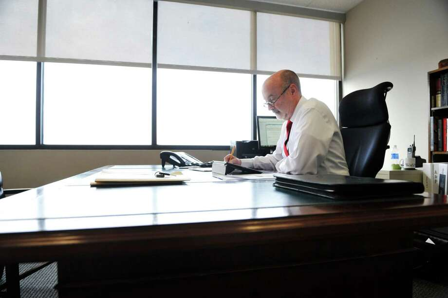 Troy Mayor Patrick Madden works in his mayoral offices on River Street Monday, Jan. 4, 2016, in Troy, N.Y. (Paul Buckowski / Times Union) Photo: PAUL BUCKOWSKI / 10034831A