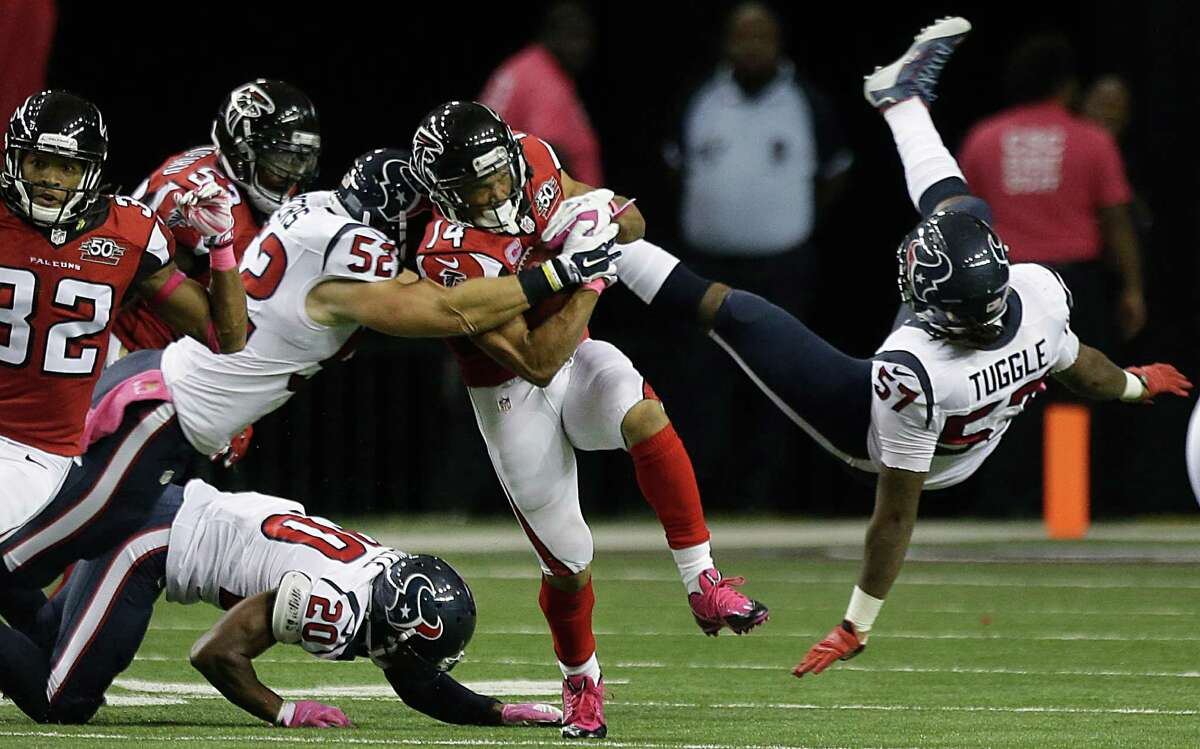 The Texans' Brian Peters (52) makes a stop on a punt against the Falcons for one his 17 special teams tackles this season, which tied him for the NFL lead.