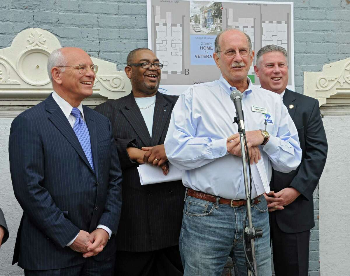 Mike Jacobson, executive director, Habitat for Humanity Capital District, speaks during a press conference at 126 Lark St. where Habitat for Humanity Capital District announced its brand new initiative ReHabitat to fight blight and revitalize neighborhoods on Tuesday, May 13, 2014 in Albany, N.Y. Standing behind him from left are Congressman Paul Tonko, Albany Common Council member Ronald Baily and Assemblyman John T. McDonald. (Lori Van Buren / Times Union)
