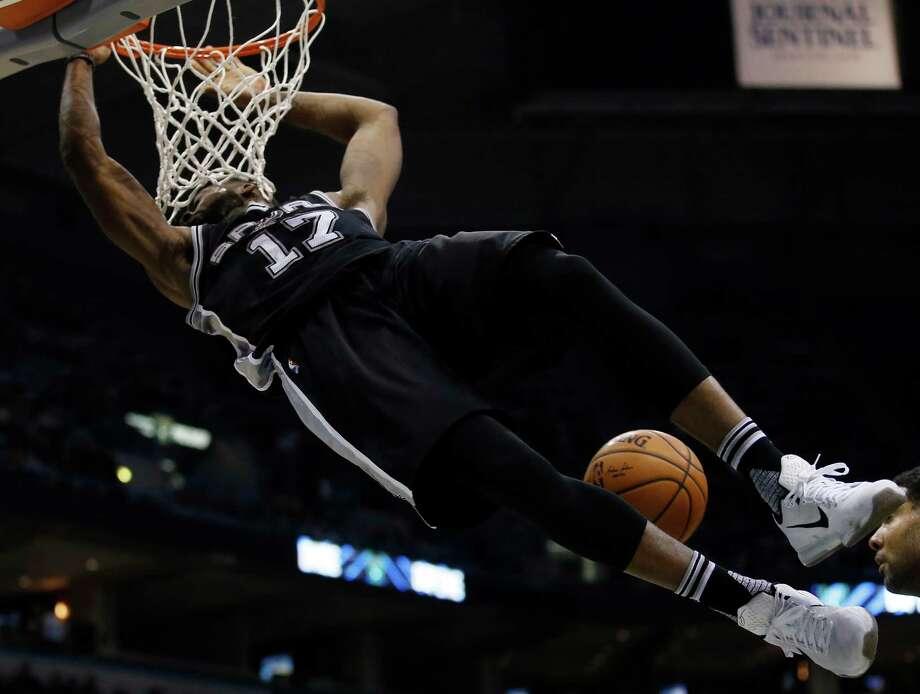 San Antonio Spurs' Jonathon Simmons dunks during the second half of an NBA basketball game against the Milwaukee Bucks Monday, Jan. 4, 2016, in Milwaukee. (AP Photo/Morry Gash) Photo: Morry Gash, Associated Press / AP