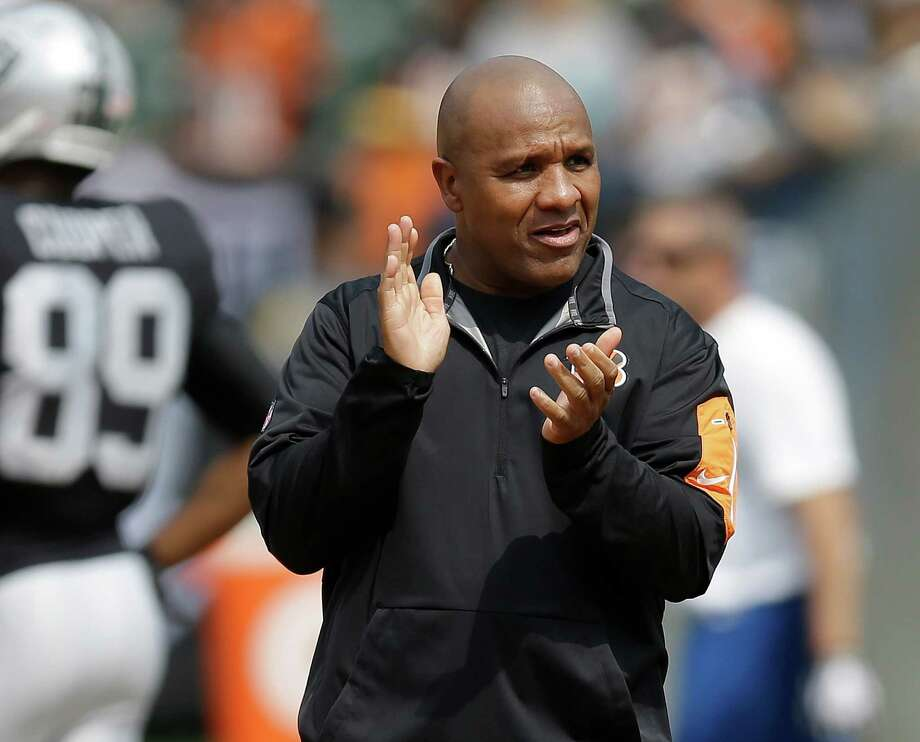 FILE - In this Sept. 13, 2015, file photo, Cincinnati Bengals offensive coordinator Hue Jackson watches as players warm up before an NFL football game against the Oakland Raiders, in Oakland, Calif. The Associated Press will announce its 2015 NFL award winners the night before the Super Bowl. Among the dozen or so noteworthy assistant coach candidates from the first half of the season, two stand out: Broncos defensive coordinator Wade Phillips and Bengals offensive coordinator Hue Jackson. (AP Photo/Ben Margot, File) Photo: Ben Margot / Associated Press / AP