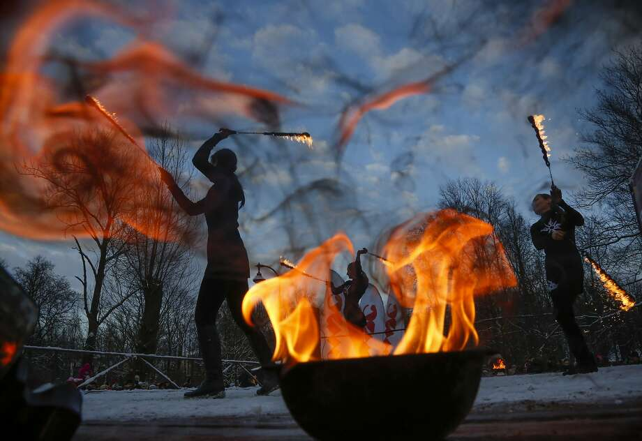 Fire show actors perform during a fire and smoke festival as they celebrate incoming Orthodox Christmas in St. Petersburg, Russia, Monday, Jan. 4, 2016. Russians continue to celebrate the New Year and Orthodox Christmas from Jan. 1 to Jan. 10. Photo: Dmitry Lovetsky, Associated Press