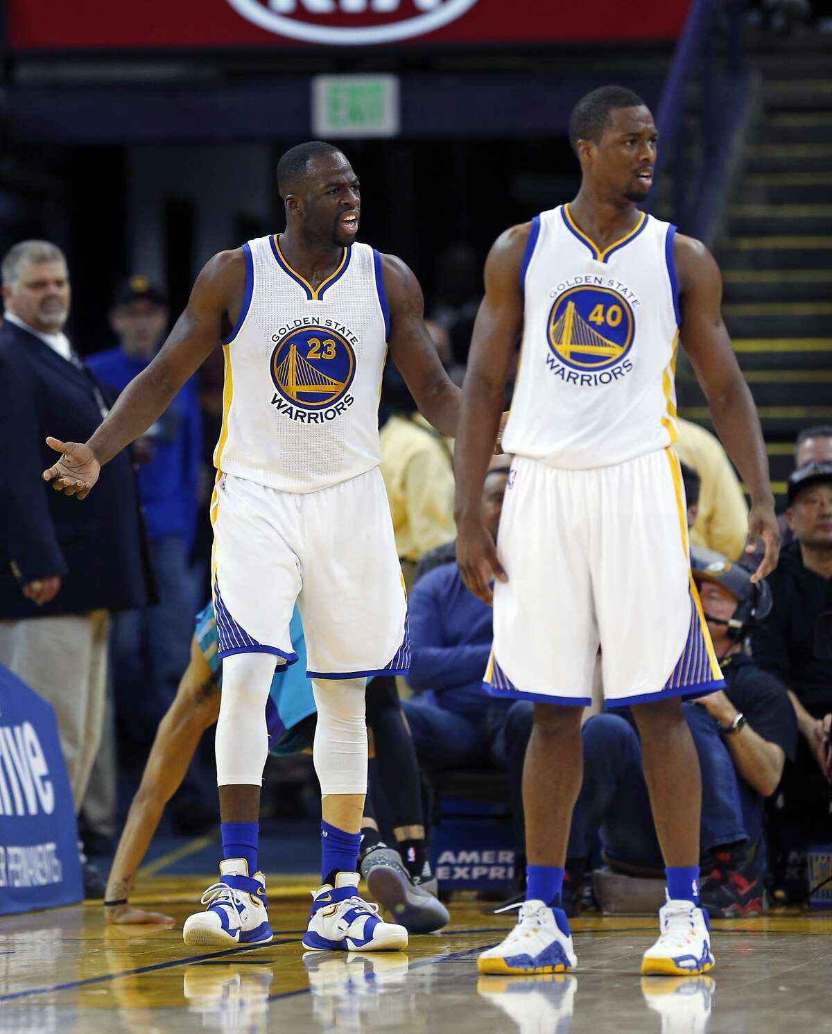 Golden State Warriors' Draymond Green and Harrison Barnes react to a foul call while playing Charlotte Hornets during NBA game at Oracle Arena in Oakland, Calif., on Monday, January 4, 2016.