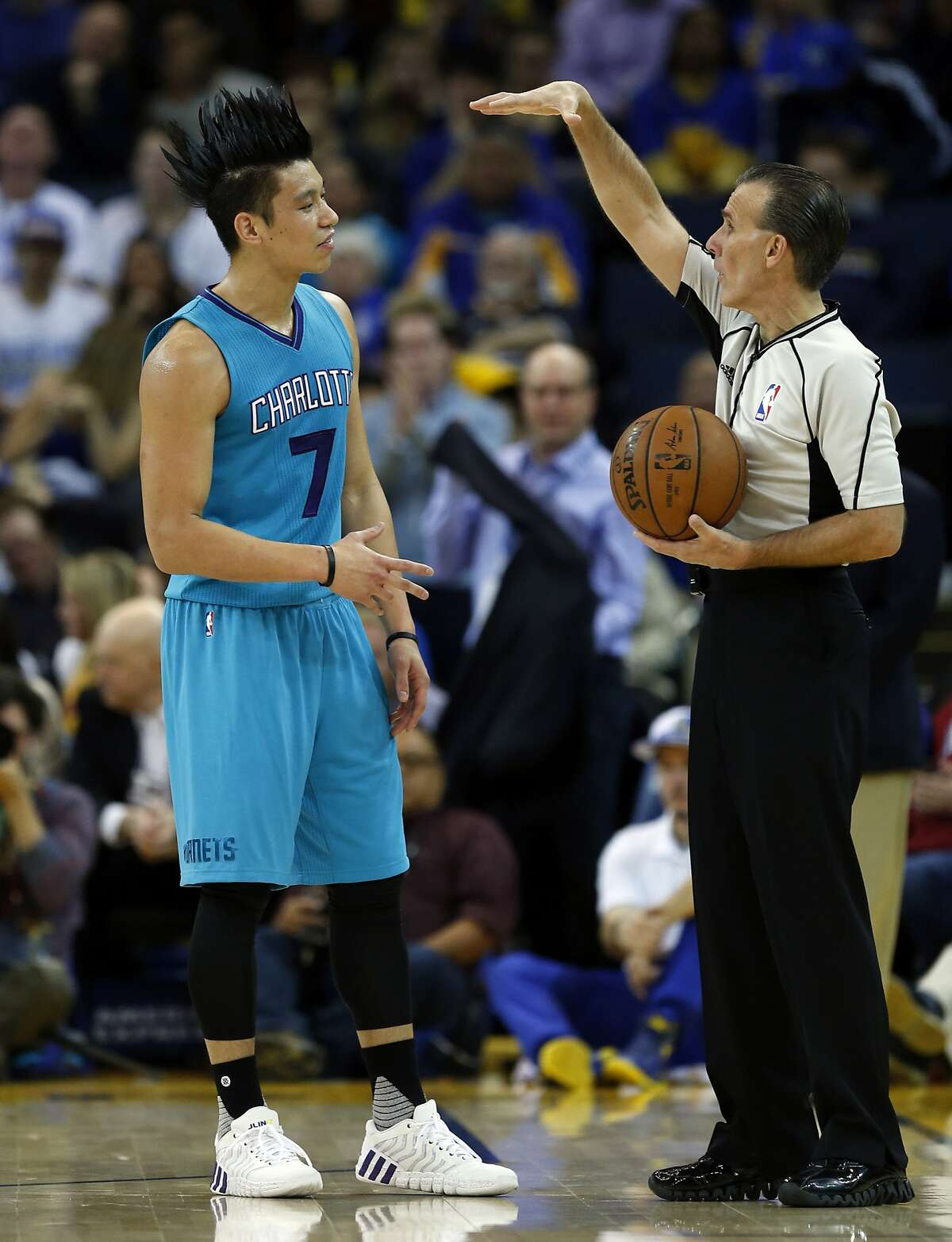 Charlotte Hornets' Jeremy Lin listens to an official in 1st quarter during NBA game against Golden State Warriors at Oracle Arena in Oakland, Calif., on Monday, January 4, 2016.