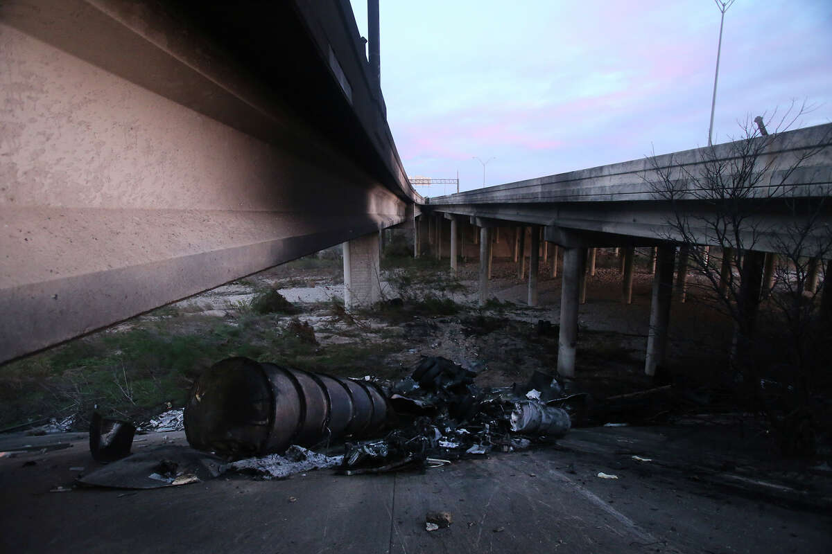 The remnants of a tanker truck are strewn under an exit ramp at Interstate 10 and La Cantera Parkway after it crashed Tuesday January 5, 2016 at about 3:00 am. . The driver of the truck was killed and eastbound lanes were closed but are now being reopened in time for the morning commute. Traffic is still delayed in the area while there is a large wrecker truck at at the scene.