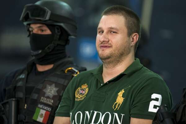 """FILE - Edgar Valdez Villareal aka """"La Barbie"""", of the Beltran Leyva drug cartel, is presented to the press at the Federal Police headquarters in Mexico City, on August 31, 2010. US-born Valdez Villarreal was extradited to the US alongside 12 other criminals, the Mexican General Attorney's office announced on September 30, 2015. The 37-year-old was a key lieutenant of Arturo Beltran Leyva, who headed the cartel that bears his name.    AFP PHOTO/Alfredo EstrellaALFREDO ESTRELLA/AFP/Getty Images"""