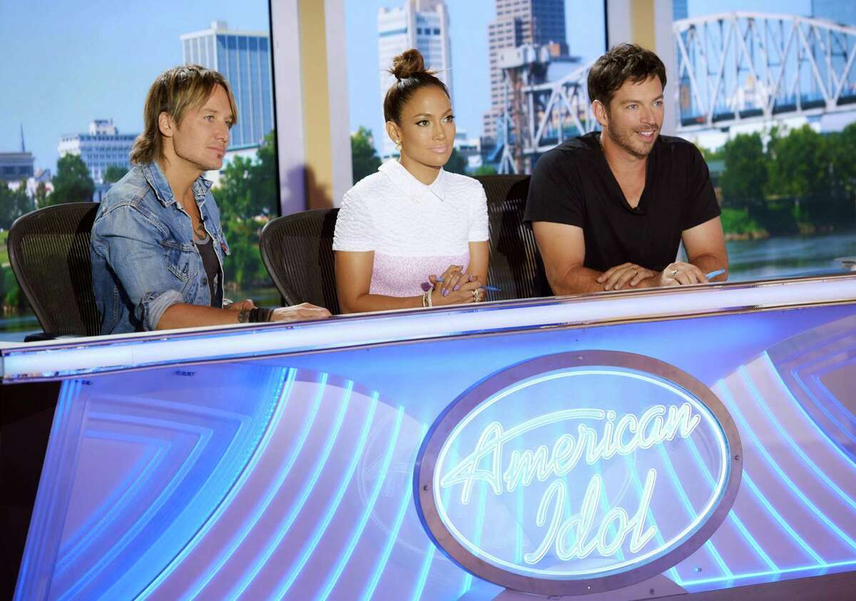 In this Aug. 22, 2015 photo released by Fox, judges Keith Urban, from left, Jennifer Lopez and Harry Connick Jr. appear at auditions for the final season of