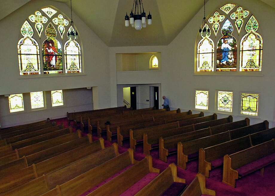 A year after buying the Westminster Presbyterian Church in downtown Beaumont, Jim Austin is still trying to find the right buyer for it. Built in 1911, the sanctuary has three large original Louis Tiffany stained glass windows in it that Austin still likes to sit and just stare at.   Dave Ryan/The Enterprise Photo: Dave Ryan