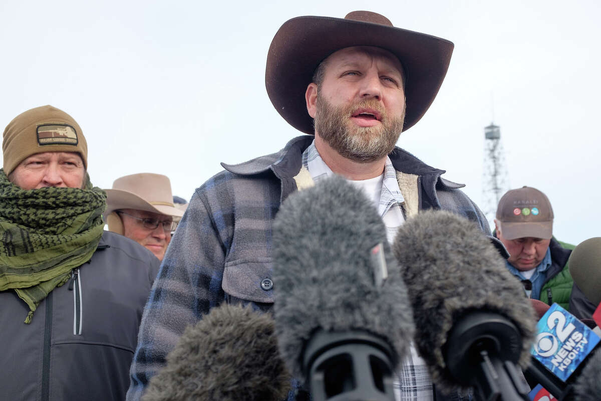 Ammon Bundy speaks to the media as the leader of a group of armed anti-government protesters who have taken over the Malheur National Wildlife Refuge Headquarters near Burns, Oregon, January 4, 2016. The FBI on January 4 sought a peaceful end to the occupation by armed anti-government militia members at a US federal wildlife reserve in rural Oregon, as the standoff entered its third day. The loose-knit band of farmers, ranchers and survivalists -- whose action was sparked by the jailing of two ranchers for arson -- said they would not rule out violence if authorities stormed the site, although federal officials said they hope to avoid bloodshed. AFP PHOTO / ROB KERR / AFP / ROB KERR