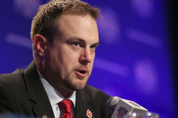 Houston Cougars head coach Tom Herman answers questions during a joint-head coach press conference for the Chick-fil-A Peach Bowl on Wednesday, Dec. 30, 2015, in Atlanta. ( Elizabeth Conley / Houston Chronicle )