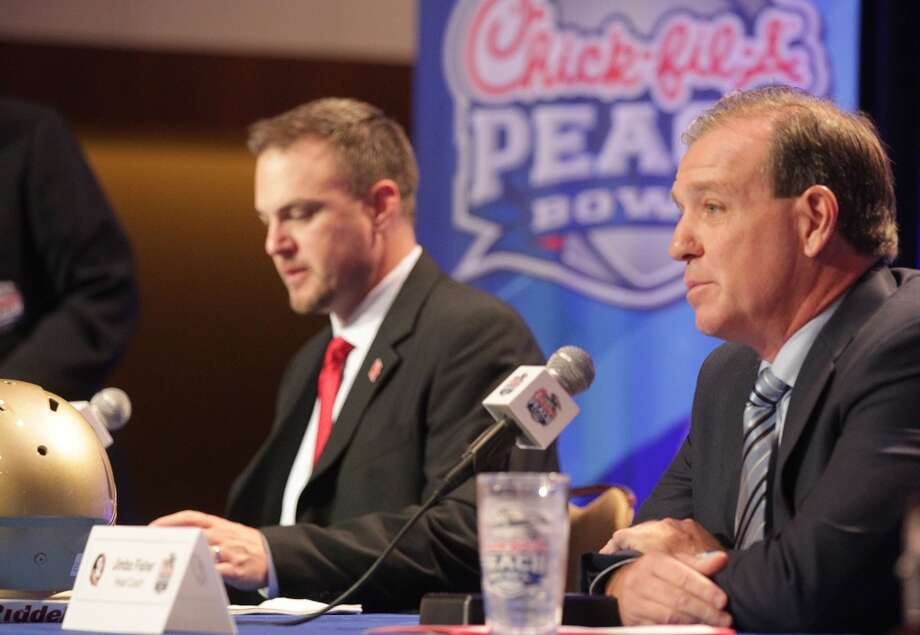 Houston Cougars head coach Tom Herman, left, and Florida State University head coach Jimbo Fisher answer questions during a joint press conference for the Chick-fil-A Peach Bowl on Wednesday, Dec. 30, 2015, in Atlanta. Now they're coaches on either side of the Texas-Texas A&M rivalry. Photo: Elizabeth Conley, Houston Chronicle