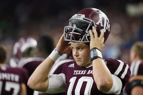 Kyle Allen #10 of the Texas A&M Aggies waits in th bench area in the first half of their game against the Arizona State Sun Devils during the Advocare Texas Kickoff at NRG Stadium on September 5, 2015 in Houston, Texas.  (Photo by Scott Halleran/Getty Images)