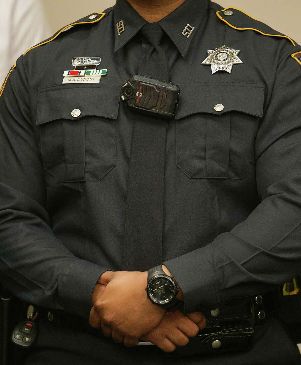 Body cameras such as this one worn by a Harris County sheriff's deputy, are being added to more local law enforcement agencies.