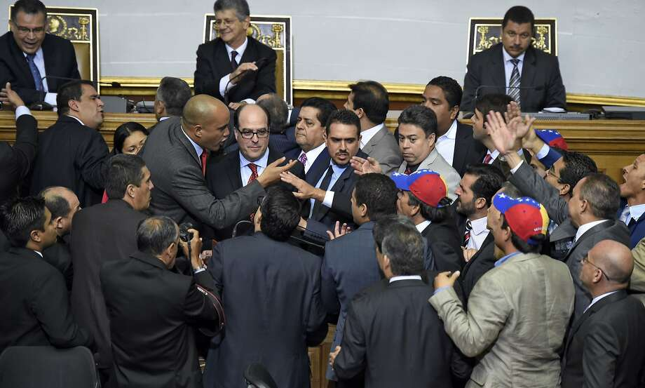 Newly elected opposition deputy Julio Borges (center) and government deputy Hector Rodriguez (second from left in center) argue during the new parliament's swearing-in ceremony in Caracas, Venezuela. Photo: Juan Barreto, AFP / Getty Images