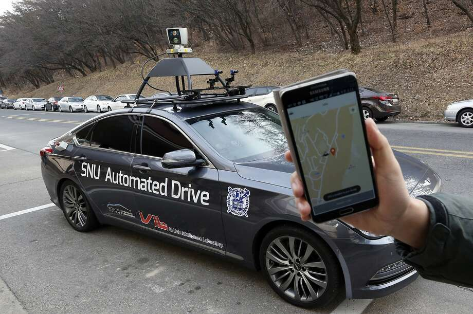 A roof fixture scans the road in a robotic sedan that has been driven for six months without an accident. Photo: Lee Jin-man, Associated Press