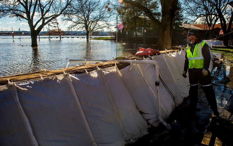 Peoria (Ill.) Public Works employee James Abbott checks a sandbag wall built along the city riverfront that keeps floodwaters from the Illinois River at bay. Photo: Fred Zwicky, Associated Press