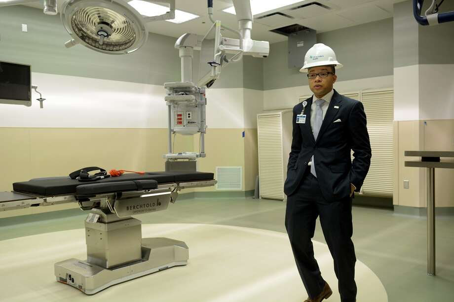 Vernon Jones, director of operations for Springwoods Village Hospitals, leads a tour into an operating room at the $120 million CHI St. Luke's Health's Springwoods medical campus, which is set to open later this month. Photo: Jerry Baker, Freelance