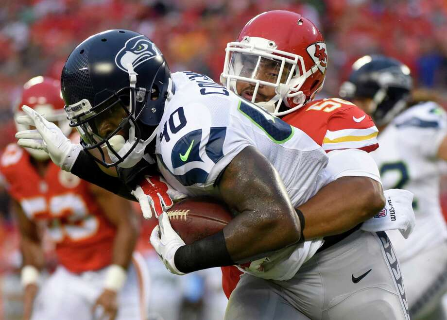 Seattle Seahawks fullback Derrick Coleman (40) is tackled by Kansas City Chiefs inside linebacker Derrick Johnson (56) during the first half of an NFL football game at Arrowhead Stadium in Kansas City, Mo., Friday, Aug. 21, 2015. (AP Photo/Ed Zurga) Photo: Ed Zurga, Associated Press / FR341445 AP