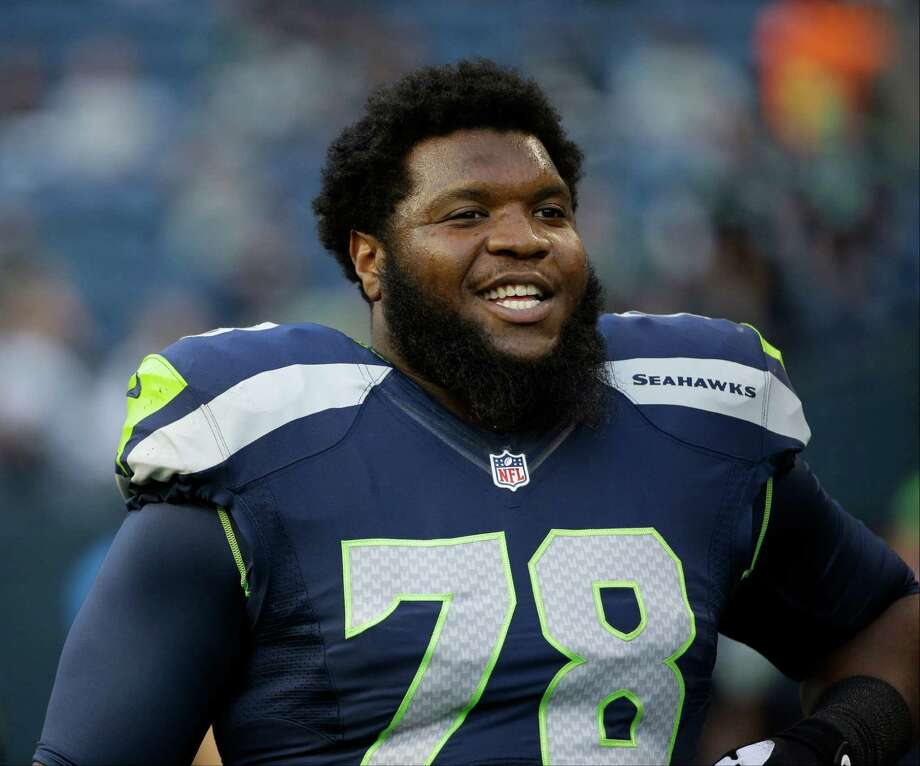 Seattle Seahawks' Alvin Bailey stretches before a preseason NFL football game between their teams, Thursday, Sept. 3, 2015, in Seattle. (AP Photo/Elaine Thompson) Photo: Elaine Thompson, Associated Press / AP