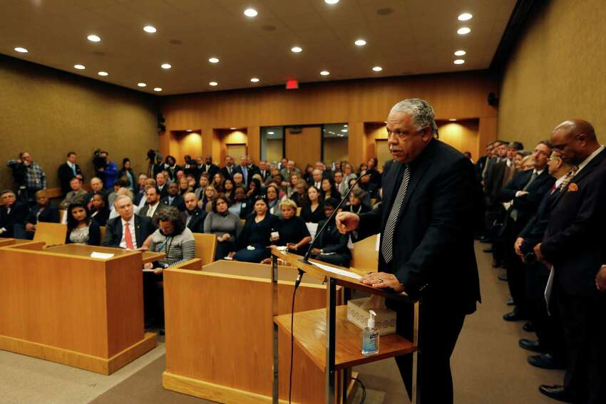 Harris County Precinct One Director of Precinct Programming David L. Benson speaks on behalf of Commissioners Court El Franco Lee's chair is draped with a black ribbon Tuesday, Jan. 5, 2016, in Houston.