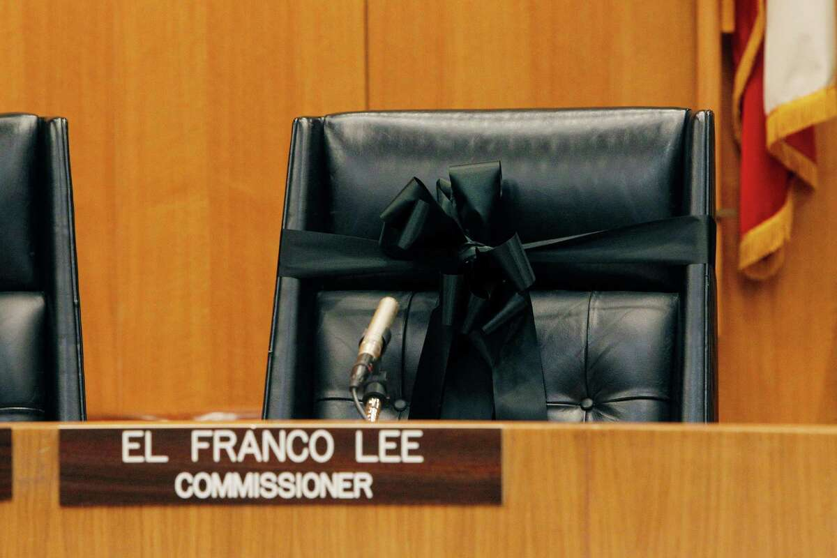 At Commissioners Court meeting El Franco Lee's chair is draped with a black ribbon Tuesday, Jan. 5, 2016, in Houston.