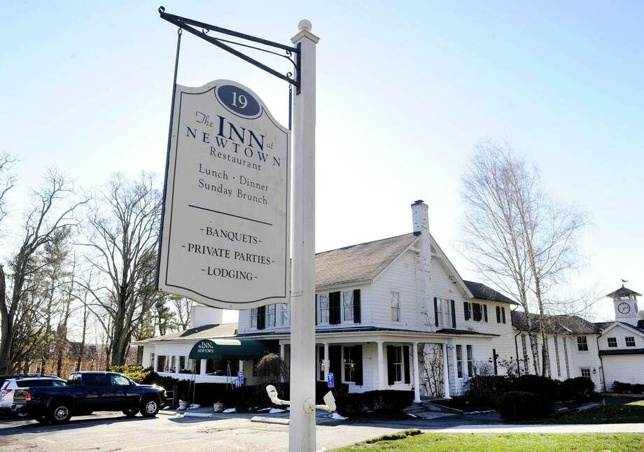 The Newtown Inn, a landmark eatery near the Newtown flagpole, is closing soon. Photo Tuesday, January 5, 2016. Photo: Carol Kaliff / Hearst Connecticut Media / The News-Times