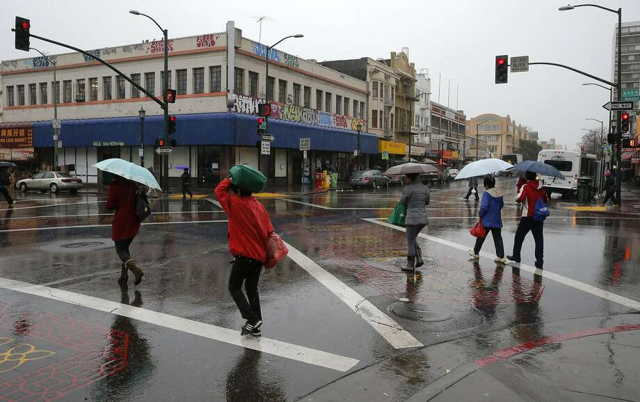 Chinatown under rainy skies at 10th and Webster  in Oakland, Calif. on Tues. January 5, 2016. Photo: Michael Macor, The Chronicle