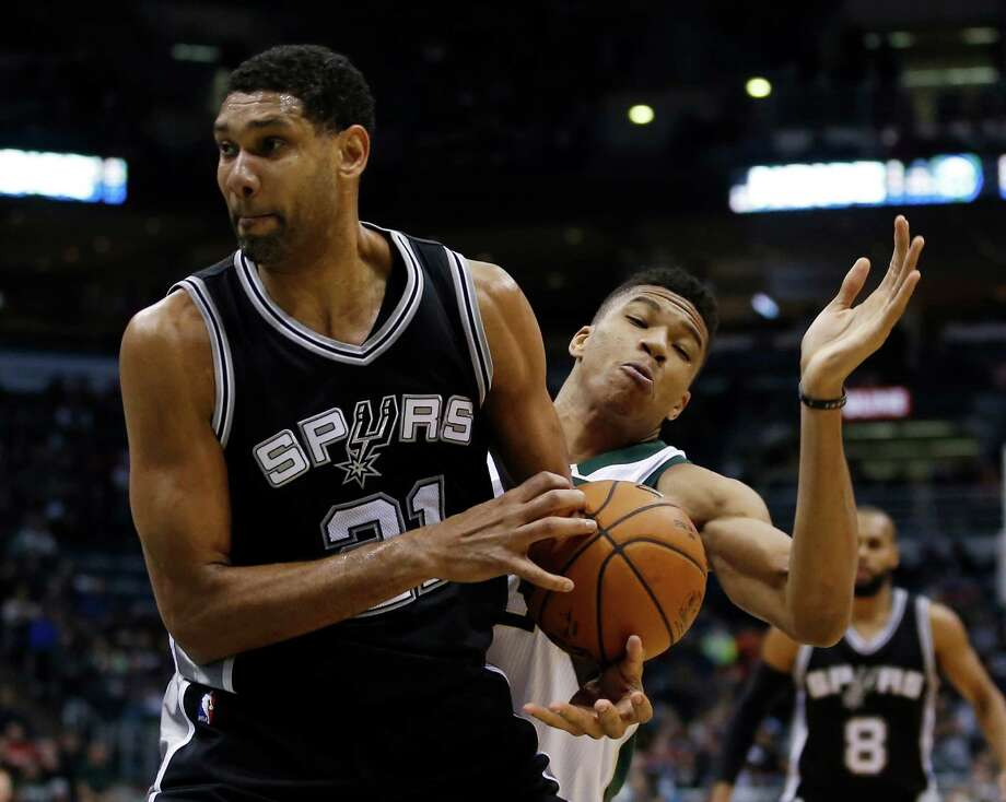 Milwaukee Bucks' Giannis Antetokounmpo tries to knock the ball away from San Antonio Spurs' Tim Duncan during the second half of an NBA basketball game Monday, Jan. 4, 2016, in Milwaukee. Photo: Morry Gash /Associated Press / AP