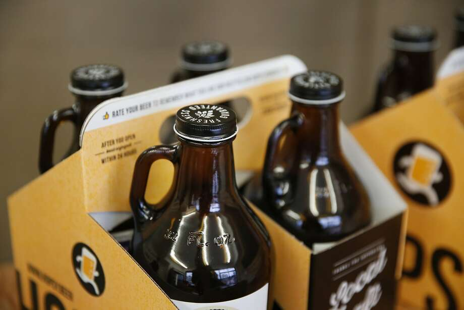 Sample growlers on display at Hopsy Jan. 3, 2016 in Albany, Calif. The company delivers growlers of local craft beer to people's homes in the Bay Area. They also sell out of their store in Albany. Photo: Leah Millis, The Chronicle