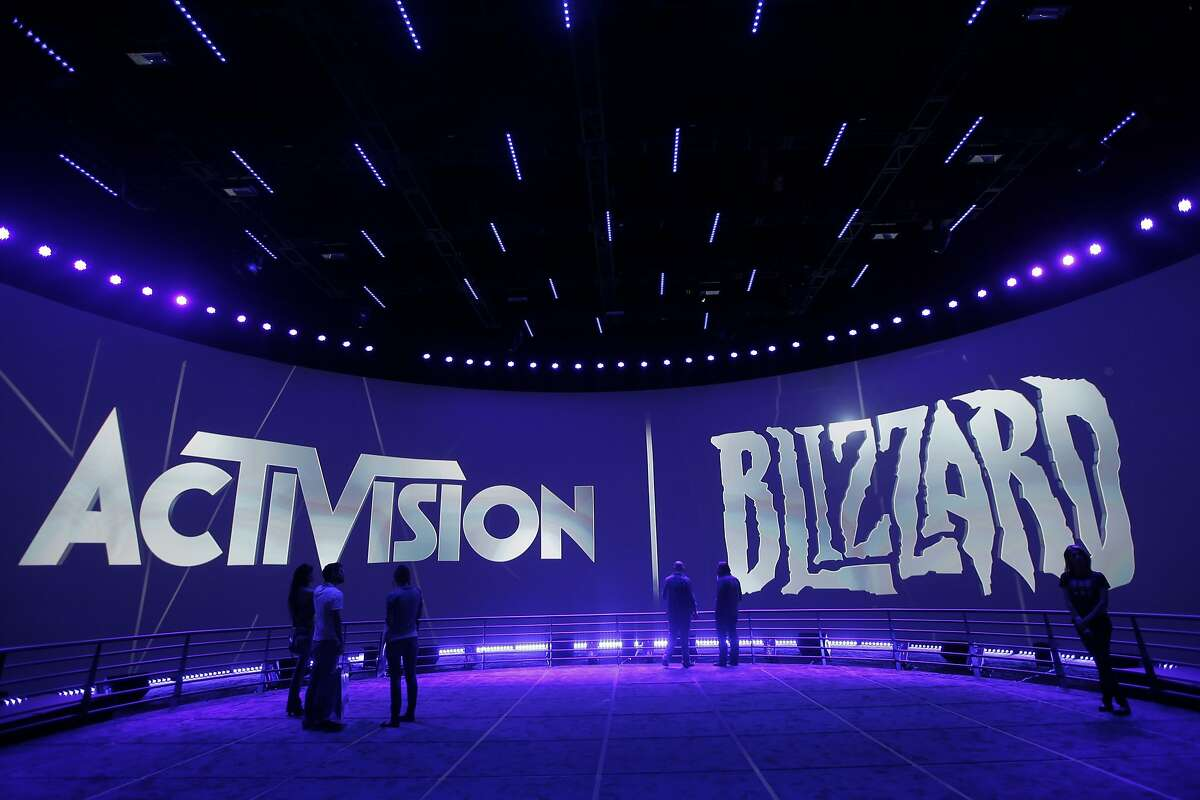 FILE - This June 13, 2013 file photo shows the Activision Blizzard Booth during the Electronic Entertainment Expo in Los Angeles.