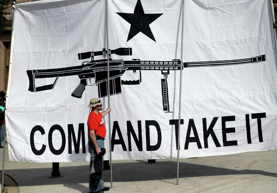 A demonstrator rallies in support of open carry gun laws in Austin. Readers express their fear of the open carry policy. Photo: Eric Gay /Associated Press / AP