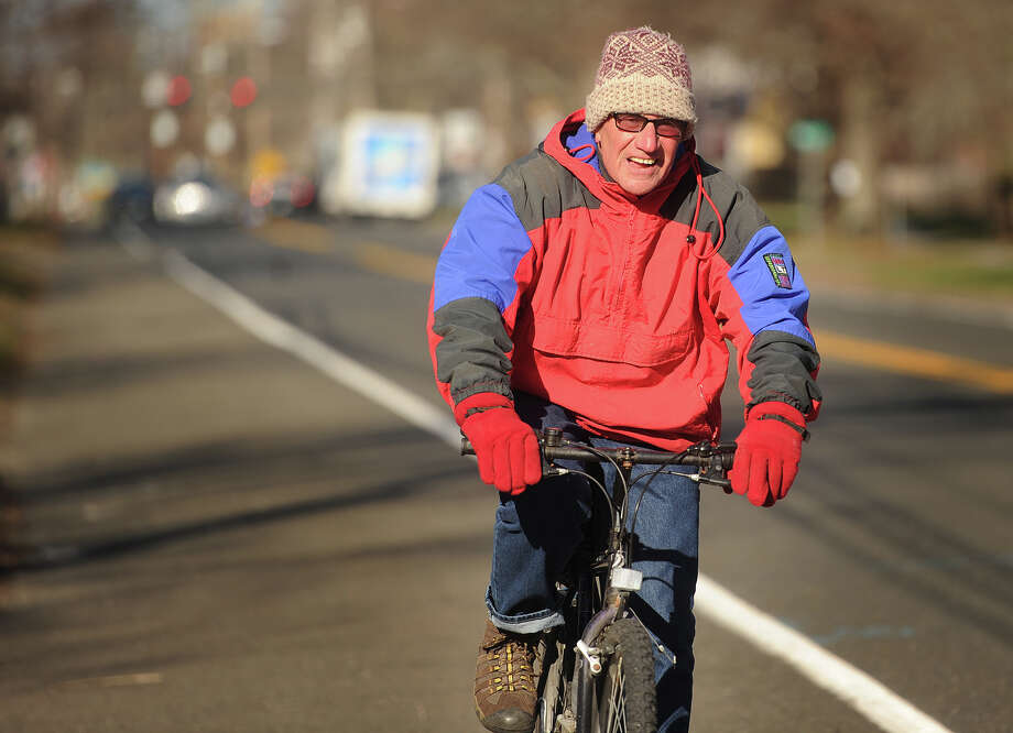 George Guman, of Stratford, braves the cold weather to take his regular bike ride down Main Street in Stratford, Conn. on Tuesday, January 5, 2016. The high temperature is expected to be in the 20s on Thursday and Friday. Photo: Brian A. Pounds / Hearst Connecticut Media / Connecticut Post