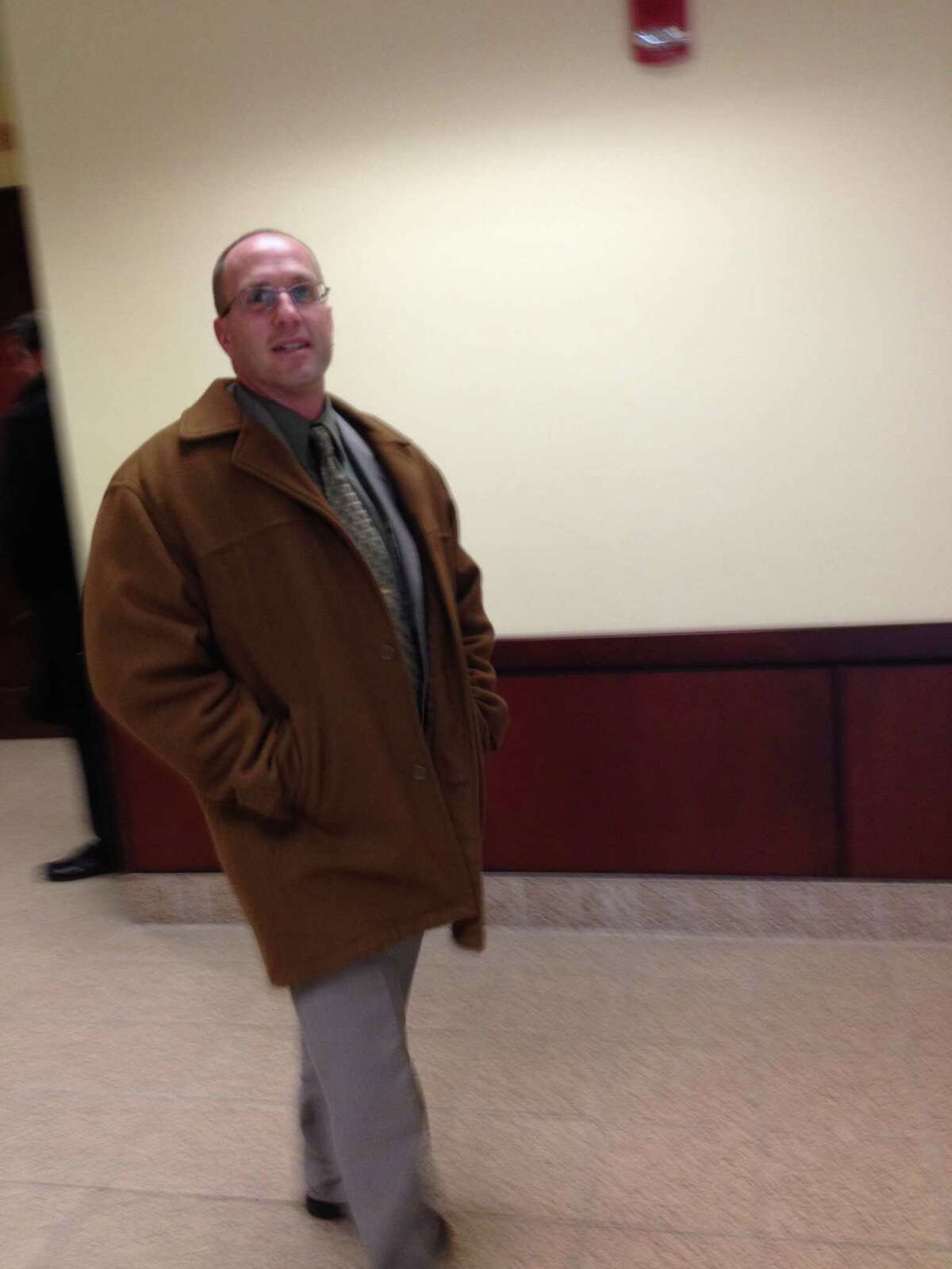 Mark Miller, an assistant deputy chief in the state Department of Corrections and Community Supervision's Office of Special Investigations, leaves Albany County Court Tuesday. Miller accused a former supervisor, James A. Ferro, of sexual harassment.