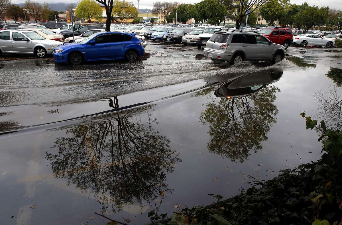 The Fruitvale BART station parking lot lost about eight spaces due to the morning rain storm, in Oakland, Calif. on Tues. January 5, 2016.