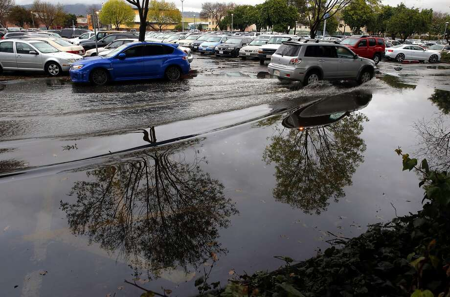 The Fruitvale BART station parking lot lost about eight spaces due to the morning rain storm, in Oakland, Calif. on Tues. January 5, 2016. Photo: Michael Macor, The Chronicle