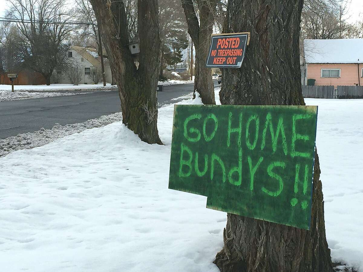 A sign tacked outside a Burns. Ore., home reflects growing community sentiment that outsider militia aren't welcome, in mid-December 2015. Self-styled patriots and militia say they are in the area to help ranchers Dwight and Steven Hammond, convicted of arson for burning federal land. The sign refers to Ammon Bundy, whose father Cliven Bundy was at the center of an armed standoff in Nevada in 2014. (Les ZaitzThe Oregonian via AP)