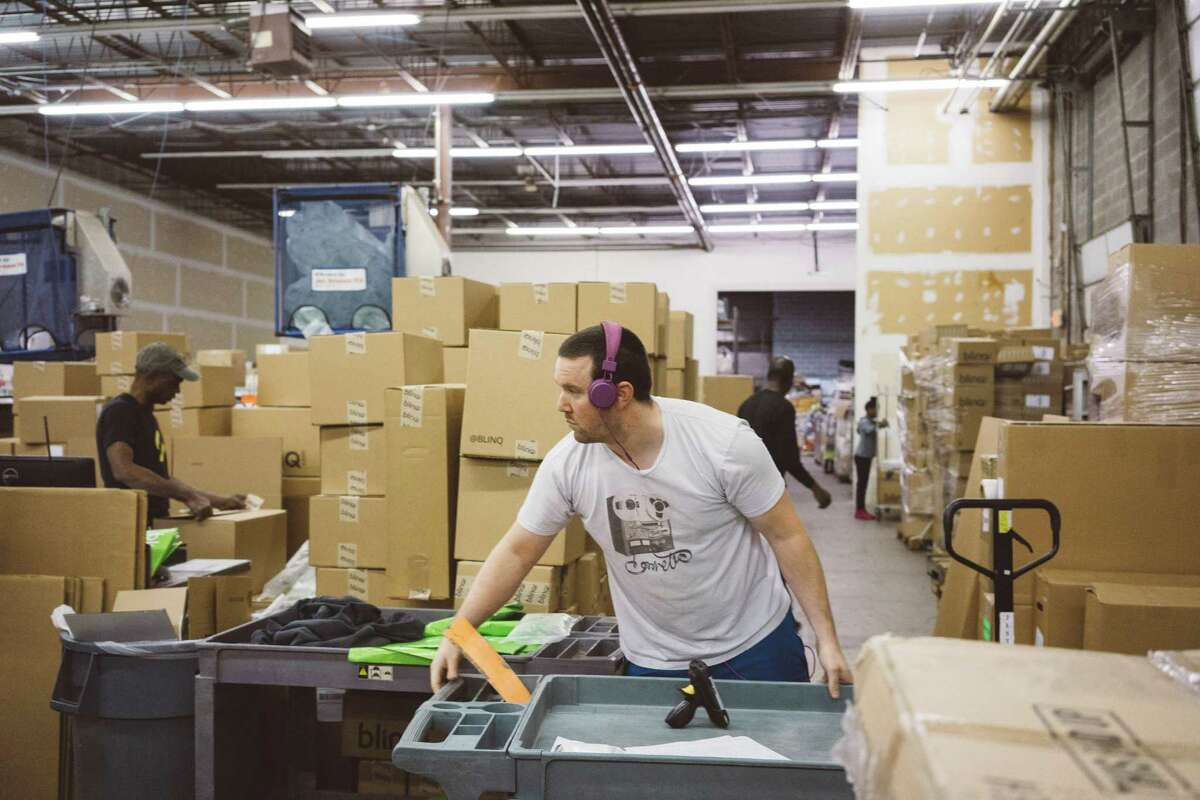 Josh Russell sorts items last month at an Optoro warehouse in Lanham, Md. Optoro tries to resell, recycle or donate merchandise.