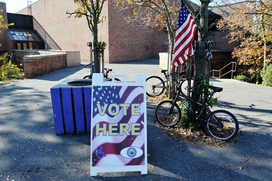Students bicycles are parked near a sign for voting at Albany High School on Tuesday, Nov. 3, 2015, in Albany, N.Y.  (Paul Buckowski / Times Union) Photo: PAUL BUCKOWSKI / 00034034B