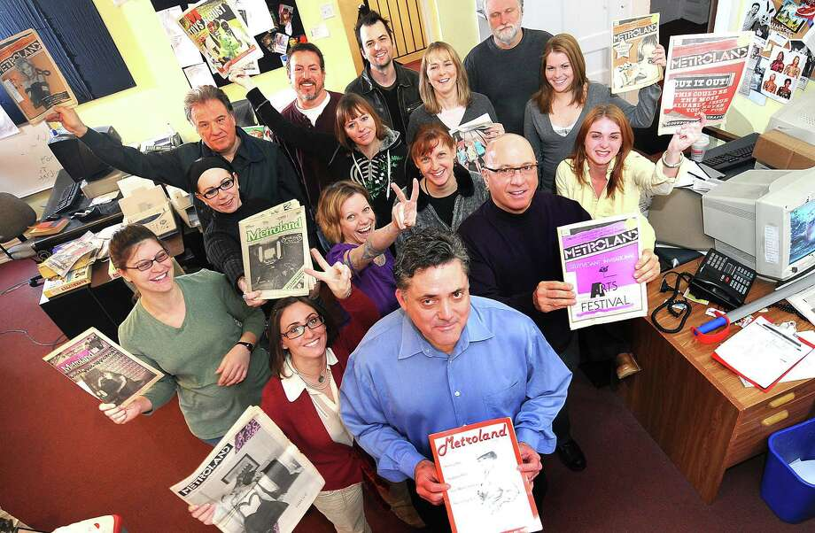 Steve Leon, front center, poses with some members of the Metroland  staff as they hold copies of past issues as part of a celebration for their 30th anniversary Tuesday, Feb. 3, 2009, in Albany, N.Y. (Steve Jacobs/Times Union) Photo: STEVE JACOBS / 00002257A