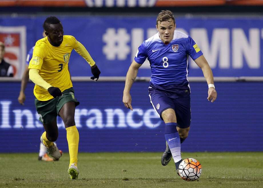FILE - In this Nov. 13, 2015, file photo, United States' Jordan Morris, right, dribbles the ball as St. Vincent and the Grenadines' Roy Richards chase  during the second half of a 2018 World Cup qualifying soccer match in St. Louis. Morris, a member of the U.S. national team, announced Tuesday, Jan. 5, 2016, that he is skipping his senior season at Stanford and will train with Werder Bremen starting Sunday at the German team's camp in Belek, Turkey.  (AP Photo/Jeff Roberson, File) Photo: Jeff Roberson, Associated Press